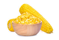 Boiled sweet corn seeds in wooden bowl wtith cob isolated Royalty Free Stock Images