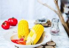 Boiled sweet corn and tomatoes with salt and black, dinner,selec Royalty Free Stock Image