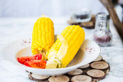 Boiled sweet corn and tomatoes with salt and black, dinner,selec Stock Photo