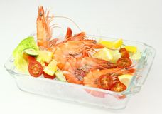 Boiled tiger Prawns. Accompanied with Salad and Citrus Fruits Stock Photography