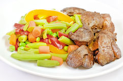 Boiled vegetables with chicken liver Royalty Free Stock Photos