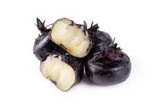 Boiled water chestnuts isolated over white background. Boiled water chestnuts isolated on a white background agriculture aquatic brown chinese cook crunchy dark stock photos