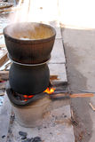 Boiled water in a stainless steel pot on a stove Royalty Free Stock Photo