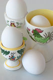 Boiled white eggs in eggcups with rooster stock photography
