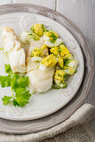 Boiled white fish cod with a sauce based on butter Stock Photography