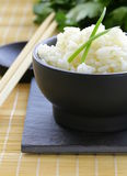 Boiled white rice in a black bowl Royalty Free Stock Image