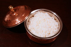 Boiled white rice copper bowl Stock Image