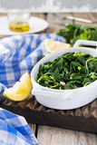 Boiled wild herbs Vlito with lemon juice and olive oil. The traditional Greek snack. Stock Image