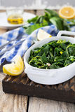 Boiled wild herbs Vlito with lemon juice and olive oil. The traditional Greek snack. Royalty Free Stock Photography