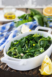 Boiled wild herbs Vlito with lemon juice and olive oil. The traditional Greek snack. Royalty Free Stock Image