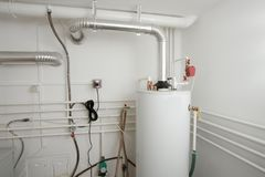 Boiler. And pipes of the heating system of a house Royalty Free Stock Image