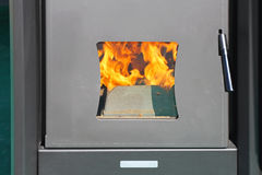 Boiler Fire. Fire Trough Heat Proof Window in Boiler royalty free stock photos
