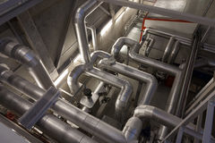 Boiler and pipelines. Modern biomass co-generation power plant boiler and pipelines stock photos