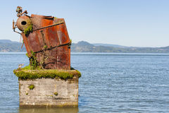 Boiler a remnant of White Star Cannery in Astoria, Oregon. Large rusted out boiler is the remnant of White Star Cannery that was destroyed by fire over 50 years Stock Images