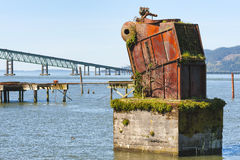 Boiler a remnant of White Star Cannery in Astoria, Oregon. Large rusted out boiler is the remnant of White Star Cannery that was destroyed by fire over 50 years Stock Photo