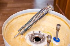 Boiler repair, replacement of broken water heating element.  royalty free stock photos