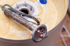Boiler repair, replacement of broken water heating element.  stock photo