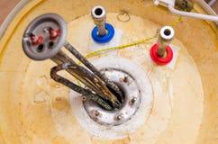 Boiler repair, replacement of broken water heating element.  royalty free stock photography