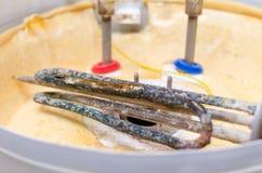 Boiler repair, replacement of broken water heating element.  stock image