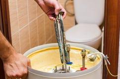 Boiler repair, replacement of broken water heating element.  royalty free stock image