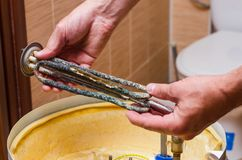 Boiler repair, replacement of broken water heating element.  stock photos
