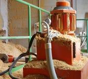 Boiler room hydraulic system supplying wood sawdust Royalty Free Stock Photography