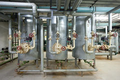 Boiler room. Interior of big boiler room, reservoirs and pipelines stock photos