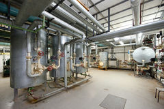 Boiler room. Interior of big boiler room, reservoirs and pipelines stock image