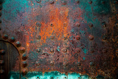 Locomotive Boiler room panel from a 1930s steam engine. The panel rusted and aged with time exhibits all the colors and hues that searing heat and years of Royalty Free Stock Image