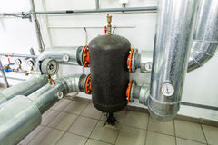 Boiler room piping and reservoir Stock Photos