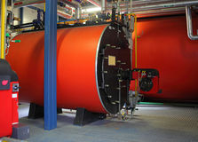 Boiler room with three gas boilers. Gas steel boiler established in modern independent boiler-house stock photo