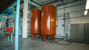 Boiler room and two red tank royalty free stock photography