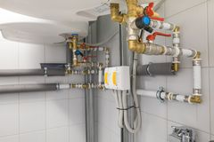 Boiler for water heating, piping system. Technical room for water heating with boiler and piping system Stock Photography
