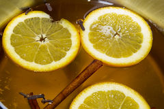 Boiling Apple Cider with Orange Slices Stock Images