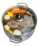 Boiling of beef broth in steel pan Stock Photo