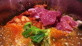 Boiling Beef Kimchi Chigae soup in hot pot stock video