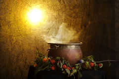 Boiling copper halloween cauldron Stock Photos
