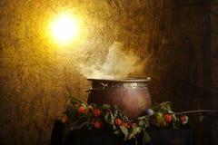 Boiling copper halloween cauldron Stock Photos