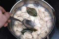 Boiling dumplings in the pan stock photo
