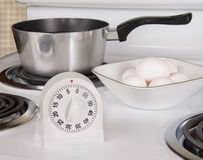 Boiling Eggs on stove Royalty Free Stock Image