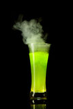Boiling green alcohol Royalty Free Stock Image