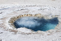 Boiling Hot Pool at Yellowstone. Water crystal clear, oderous and deadly at the Old Faithful site Royalty Free Stock Photo
