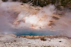 Boiling hot water pond in Yellowstone National park stock image