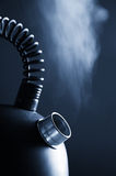 Boiling kettle. Blue boiling kettle on a dark background Royalty Free Stock Images
