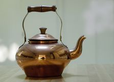 Boiling kettle. You don,t found a lot of kitchenware stuf from copper royalty free stock photography