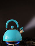 Boiling kettle on hob Royalty Free Stock Photo