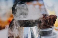 Steam of the kettle. The boiling kettle produce the white steam to an environment stock image