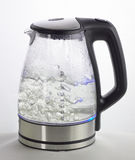 Boiling kettle. Transparent kettle with hot boiling water royalty free stock photography