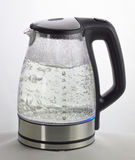 Boiling kettle. Transparent kettle with boiling water stock photos