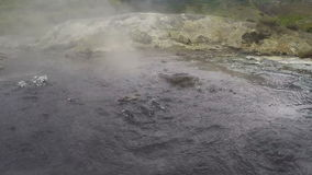 Boiling mineral water in natural volcanic hot springs stock footage